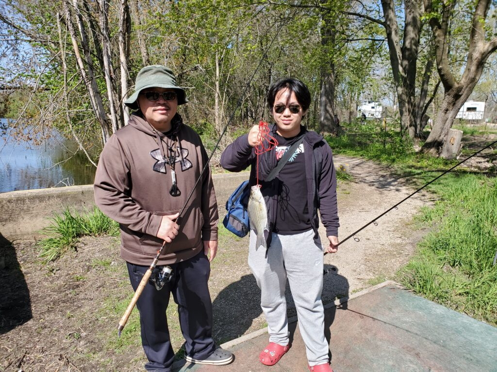 Friends with one WHite Bass, from Oshkosh Area are enjoing a day out for some fishing.  Nice fish and interested in coming back for a bigger catch.